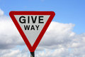 Uk give way sign horizontal photograph of with cloudy sky Stock Images