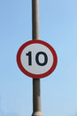 Uk mph speed limit sign metal on pole against blue sky Royalty Free Stock Images