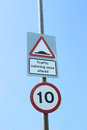 Uk mph speed limit and traffic calming speed bumps signs Royalty Free Stock Photography