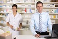 UK nurse and pharmacist working in pharmacy Stock Images