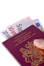 Uk passport and euros holding a with Stock Photography