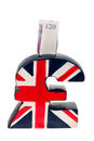 UK pound symbol piggy bank Stock Image