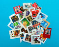 UK stamp assortment, still on envelope, on blue Royalty Free Stock Image