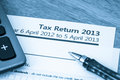 Uk tax return cool toned image of income form for Royalty Free Stock Image