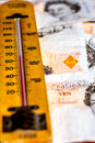 UK ten pound notes and thermometer Royalty Free Stock Photo