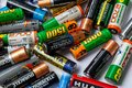 Ukraine. Khmelnitsky. September 14, 2018. Closeup of pile of used alkaline batteries Royalty Free Stock Photo