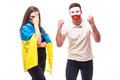 Ukraine vs Poland on white background. Football fans of national teams demonstrate emotions Royalty Free Stock Photo