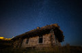 Ukrainian abandoned house in the old village.Against the background of the Milky Way