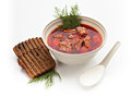 Ukrainian borsch red beet soup with slices of black bread sour cream on a white background Stock Image