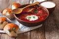 Ukrainian borscht red soup with garlic buns on the table. horizo Royalty Free Stock Photo