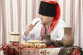 Ukrainian cossack in national clothes cradle smokes tobacco Stock Images