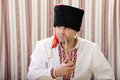 Ukrainian cossack in national clothes smokes a pipe with tobacco Stock Image