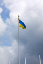 Ukrainian flag on a flagpole in the wind develops in the background of the sky Royalty Free Stock Photos