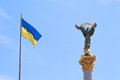 Ukrainian flag and Monument to Berehynia in Kiev Royalty Free Stock Photo
