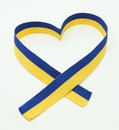 Ukrainian flag in the ribbon of heart on a white background Stock Image