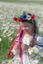 Ukrainian girl on chamomile field Stock Image