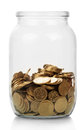Ukrainian hryvnia coins in glass jar on white background Royalty Free Stock Photo