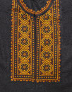 Ukrainian men s dress shirt yellow embroidery on a black background Royalty Free Stock Images