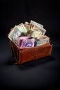 Ukrainian money in the wallet pile of on black background Stock Image