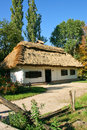 Ukrainian rural cottage with a straw roof ancient traditional at autumn season Stock Images