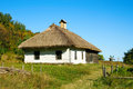 Ukrainian rural cottage with a straw roof ancient traditional at autumn season Royalty Free Stock Images