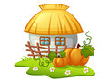 Ukrainian rural house with wooden fence and pumpkins