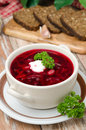 Ukrainian and russian national red borsch with sour cream closeu Stock Photos