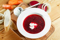 Ukrainian and russian red-beet soup borscht with garlic and sour cream Royalty Free Stock Photo