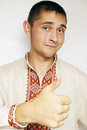 Ukrainian shows thumb up gesture man in traditional dress Royalty Free Stock Image