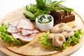 Ukrainian snack cuisine smoked chicken salted mushrooms pickled and crispy bread Stock Photo