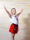 Ukrainian talented boy posing with raised arms and an artistic attitude while wearing pride a traditional folk costume Stock Photography