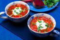 Ukrainian traditional borsch. Russian vegetarian red soup  in blue bowl on blue wooden background.  Borscht, borshch with beet. Tw Royalty Free Stock Photo