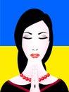 image photo : Ukrainian woman prays.