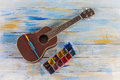 Ukulele with brush and color palette
