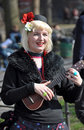Ukulele-Dame Busker in New York Stockfotos