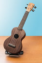stock image of  Ukulele full view on wooden background