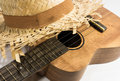 Ukulele and hat in white background Royalty Free Stock Image