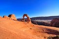 Ultra wide angle shot of delicate arch in late fall arches national park near moab utah taken at sunset with snow on la sal Royalty Free Stock Photo