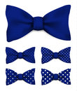 Ultramarine blue bow tie with white dots realistic vector illustration