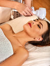 Ultrasonic facial treatment on ultrasound face machine. Royalty Free Stock Photo