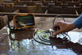 Ultrasonic test to detect imperfection or defect of steel plate Royalty Free Stock Photo