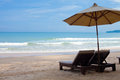 Umbrella and beach beds on sea Royalty Free Stock Photo