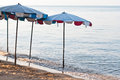 Umbrella on the beach in evening Royalty Free Stock Photo