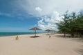 Umbrella and beautiful beach Royalty Free Stock Image