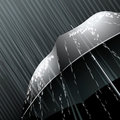 The umbrella black opened under falling rain Stock Image