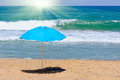 Umbrella blue on a beach Stock Photography