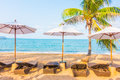 Umbrella and chair on the tropical beautiful beach sea Royalty Free Stock Image