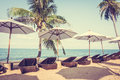 Umbrella and chair on the tropical beautiful beach sea vintage filter Royalty Free Stock Images