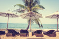 Umbrella and chair on the tropical beautiful beach sea vintage filter Stock Images