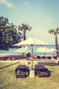 Umbrella and chair on the tropical beautiful beach sea vintage filter Royalty Free Stock Photos
